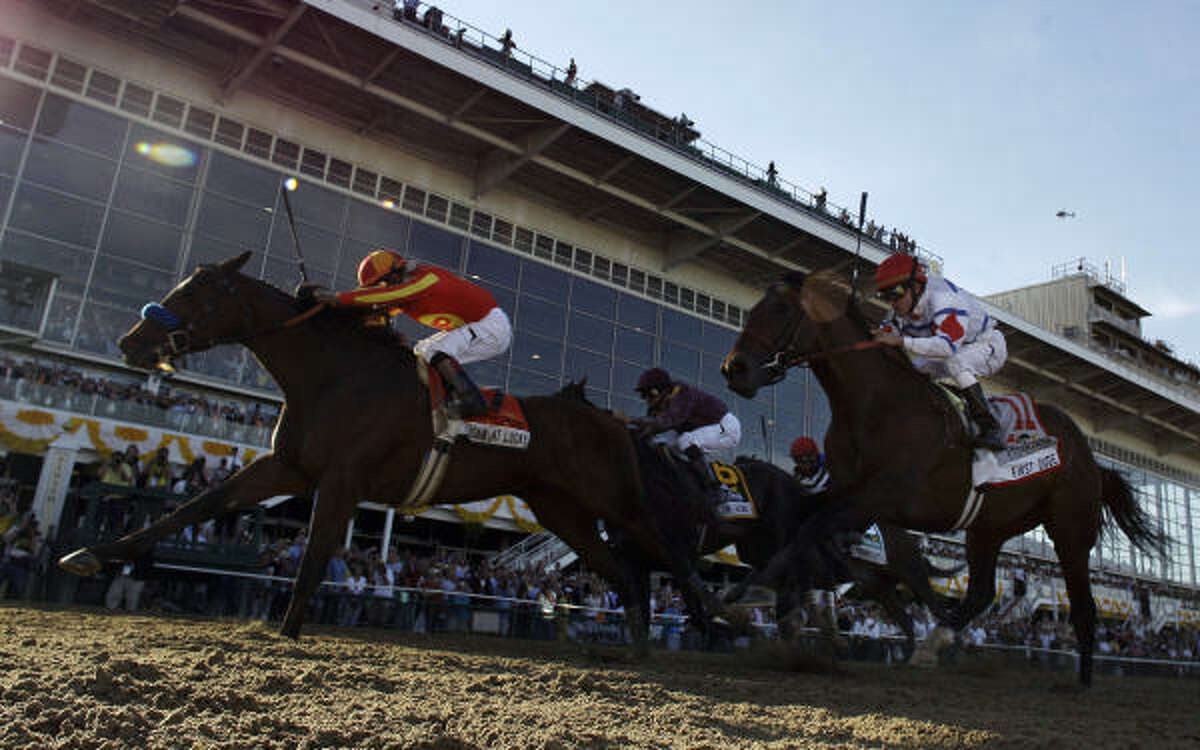 Lookin At Lucky, left, ridden by Martin Garcia, wins the 135th Preakness Stakes ahead of First Dude, right, who takes second place in front of Jackson Bend, who takes third place, on Saturday at Pimlico Race Course in Baltimore.