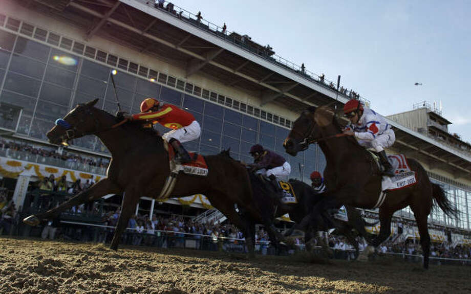 Lookin At Lucky, left, ridden by Martin Garcia, wins the 135th Preakness Stakes ahead of First Dude, right, who takes second place in front of Jackson Bend, who takes third place, on Saturday at Pimlico Race Course in Baltimore. Photo: Rob Carr, AP