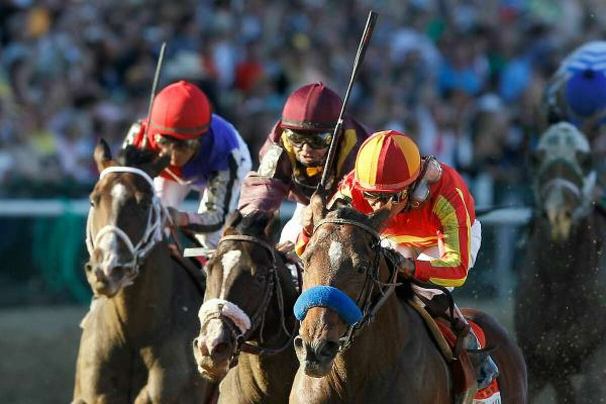 Lookin at Lucky, ridden by Martin Garcia, crosses the finish line ahead of First Dude and Jackson Bend.