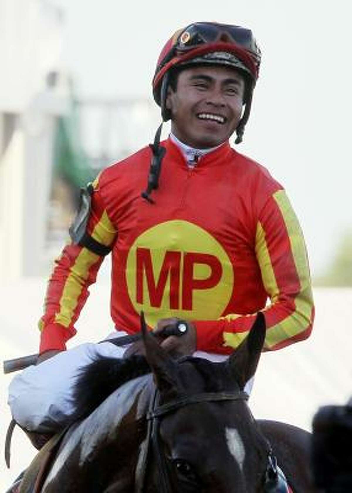 Martin Garcia celebrates after riding Lookin At Lucky to victory in the Preakness Stakes.
