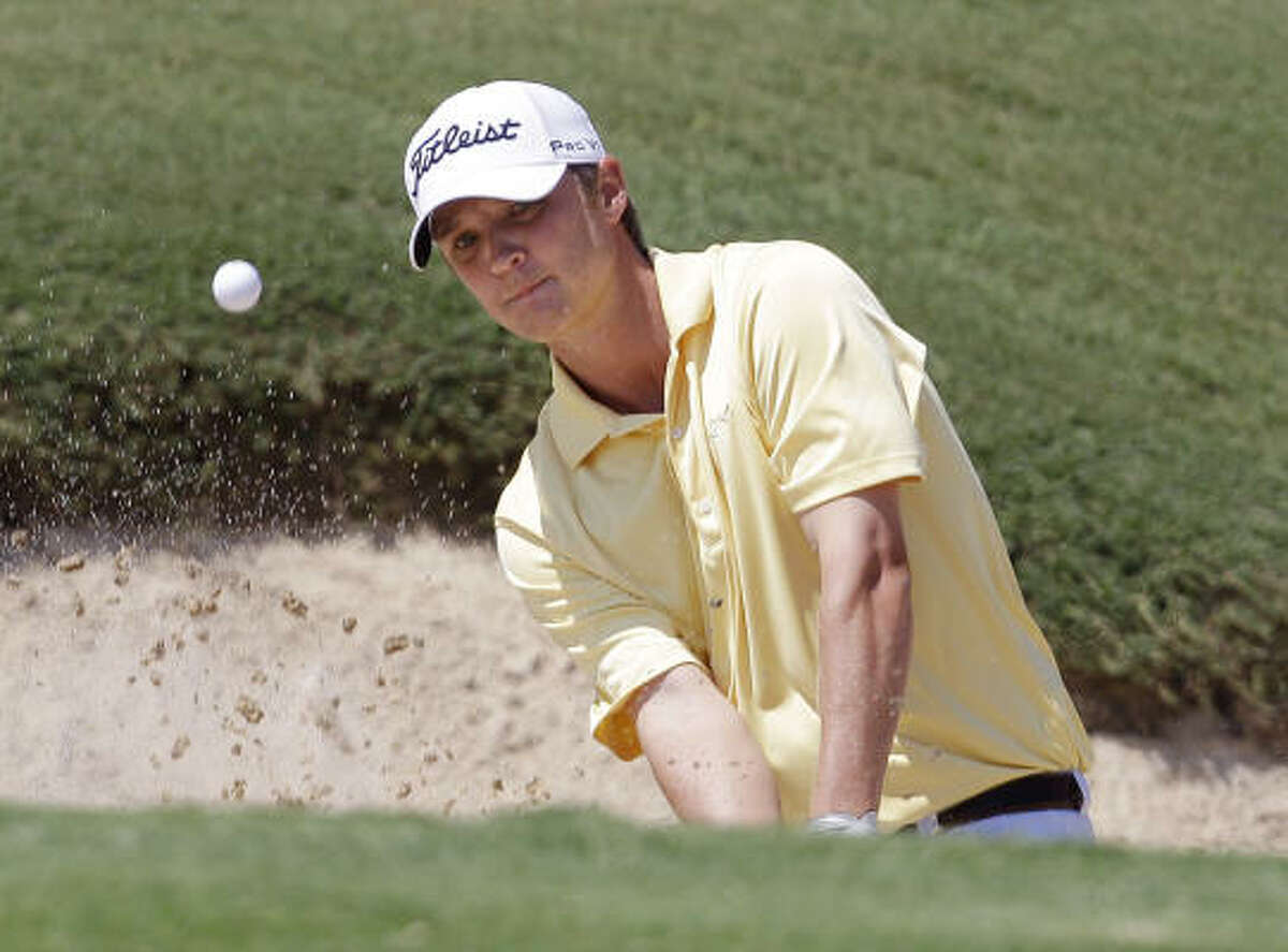 Matt Jones hit a 1-under 67 in the second round of the Texas Open on Saturday to finish in a four-way tie for first place with Jimmy Walker, James Nitties and Brett Wetterich heading into the final two rounds at TPC San Antonio.