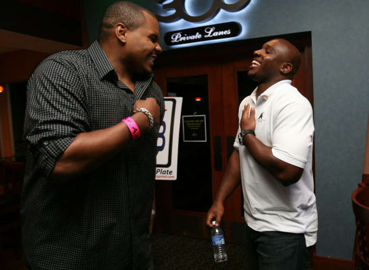Texans linebacker DeMeco Ryans, right, shares a laugh with his teammate Chester Pitts.