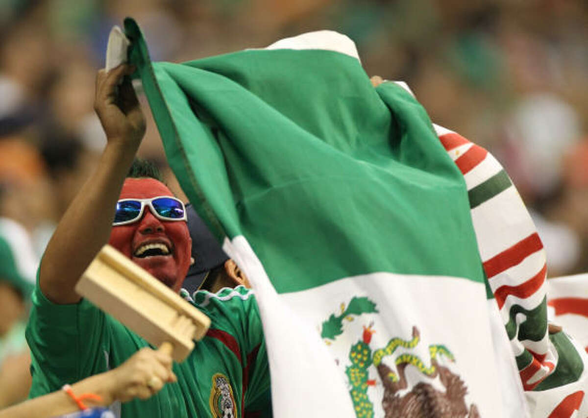 Victor Lara of Austin cheers as the Mexico national team hits the field.