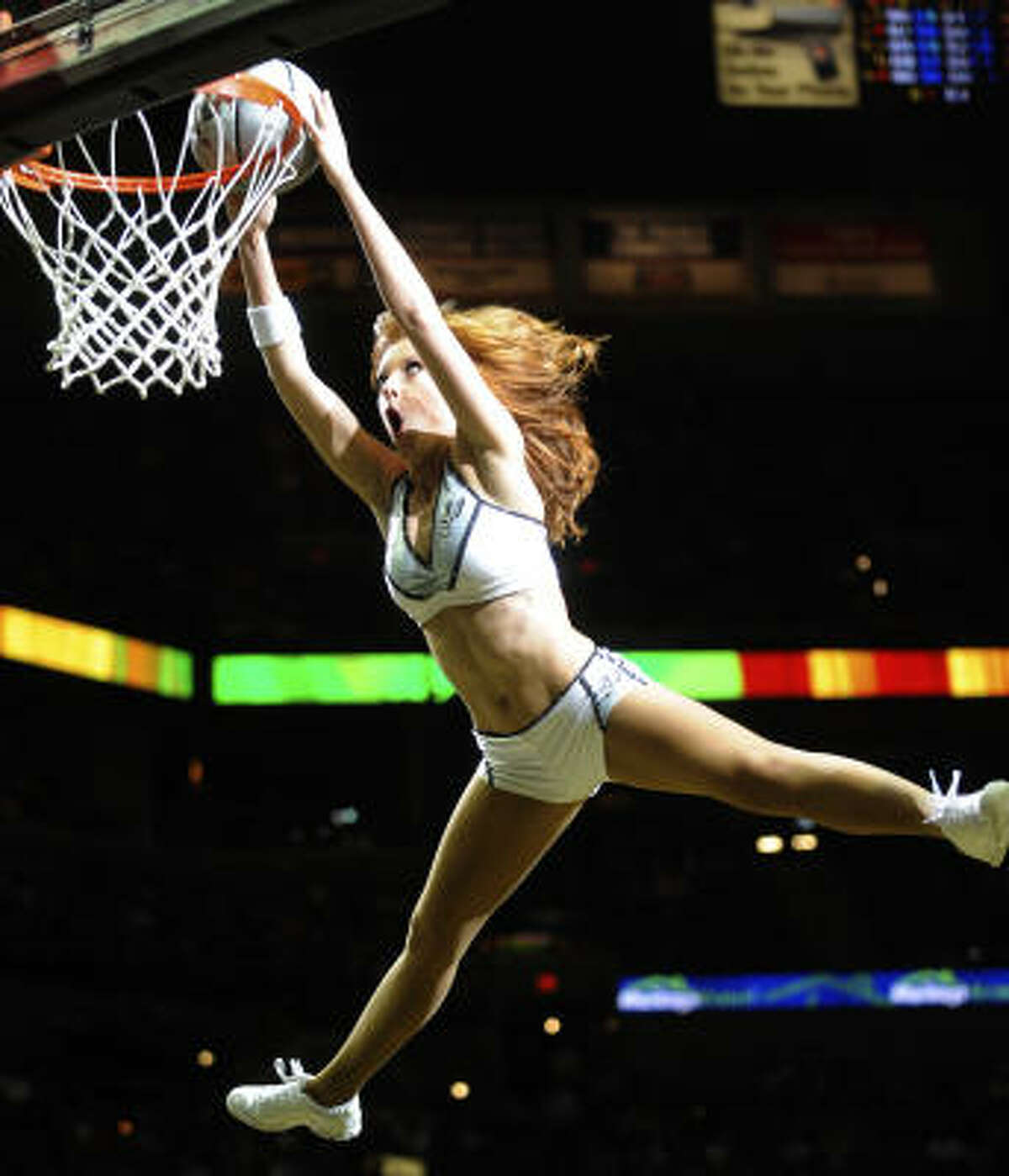 A Silver Dancer dunks the ball during a timeout of the Rockets-Spurs game in San Antonio on Wednesday, March 31.