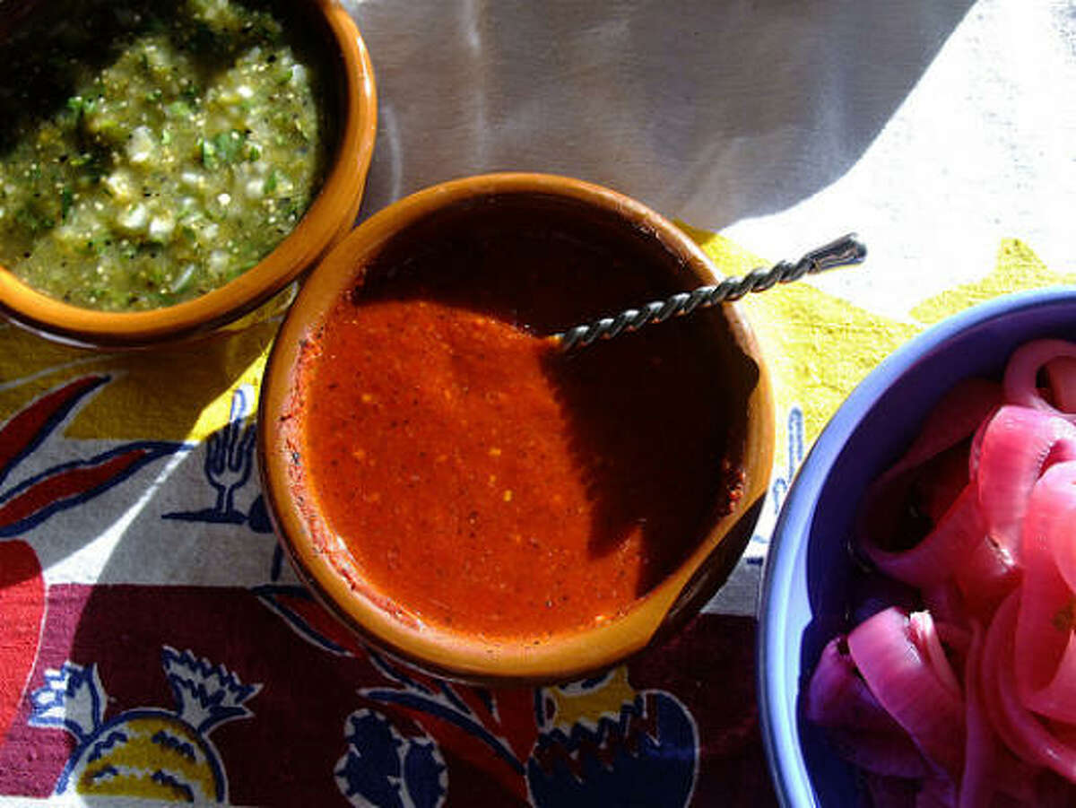 Traditional habanero salsa, center, for the cochinita pibil tacos at my neighbor Todd Romero's Cinco de Mayo fest. Pickled red onions to the right; tomatillo salsa to the left.