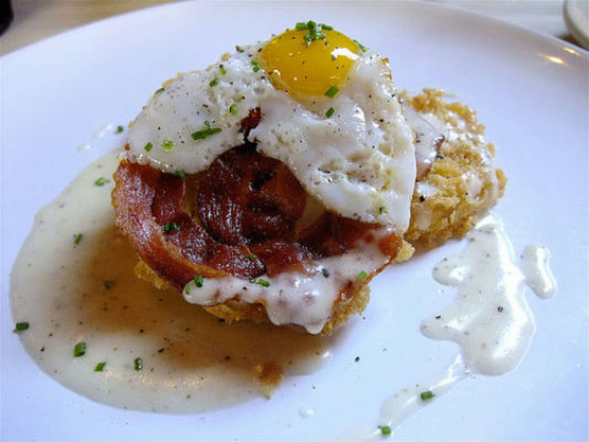 """Fried green tomatoes with pancetta crisp, sunnyside quail egg and the lightest country """"gravy,"""" atRainbow Lodge."""