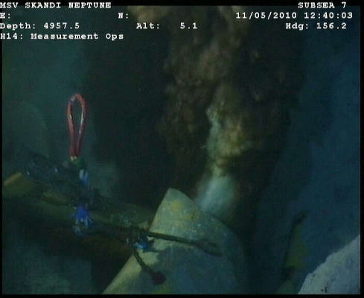 These newly released images from the site of the Deepwater Horizon disaster show the main oil leak at the end of the riser pipe. A wrench and a robotic sub can be seen in the background. The accident at the Macondo well has spewed at least 4 million gallons of oil into the Gulf in the last three weeks.