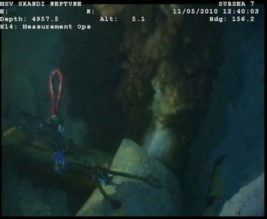 These newly released images from the site of the Deepwater Horizon disaster show the main oil leak at the end of the riser pipe. A wrench and a robotic sub can be seen in the background. The accident at the Macondo well has spewed at least 4 million gallons of oil into the Gulf in the last three weeks. Photo: BP Photo