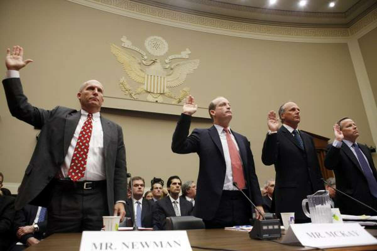 From left, Steven Newman of Transocean, Lamar McKay of BP, Timothy Probert of Halliburton, and Jack Moore of Cameron, are sworn in before they testify during a House subcommittee hearing on the Gulf Coast oil spill, Wednesday, May 12, 2010, in Washington.