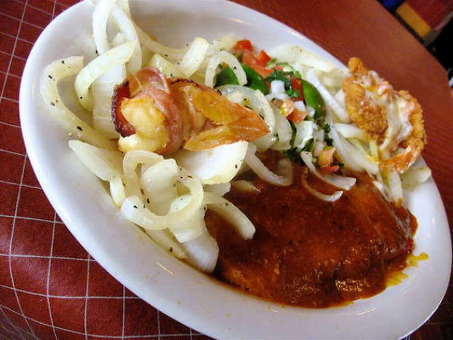 A la carte cheese enchilada with a shrimp Acapulco & a bacon-wrapped shrimp, Little Santos Photo: Alison Cook, Chronicle