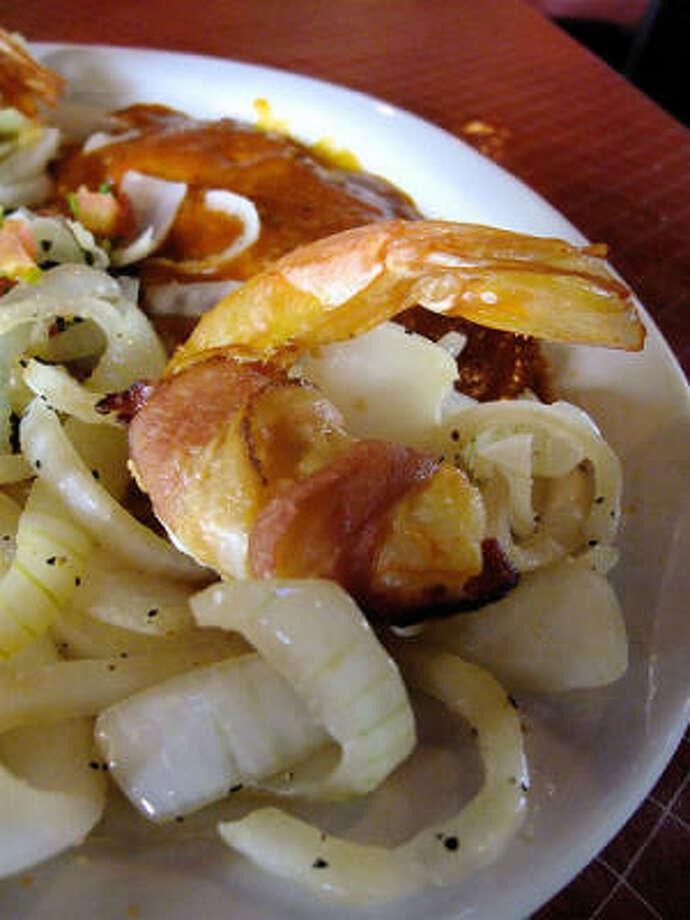 Bacon-wrapped shrimp, Little Santos. Photo: Alison Cook, Chronicle