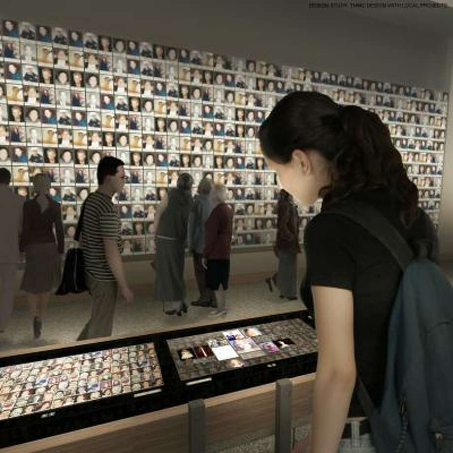 This undated artist's rendering provided by the National September 11 Memorial & Museum shows a planned exhibition gallery that will include a wall of photographs of every victim of the 2001 attack and 1993 World Trade Center bombing. Photo: AP