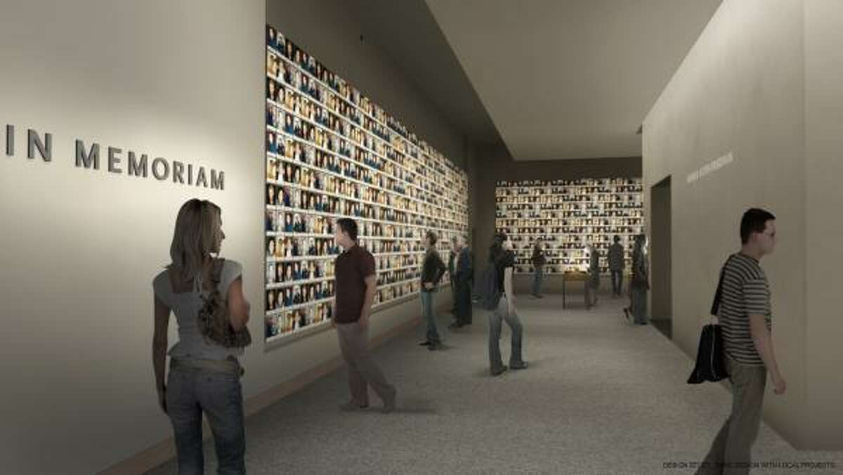 This undated artist's rendering provided by the National Sept. 11 Memorial & Museum shows a planned exhibition gallery that will include a wall of photographs of every victim of the 2001 attack and 1993 World Trade Center bombing. A multimedia gallery will include several photographs, audiotapes and written remembrances.