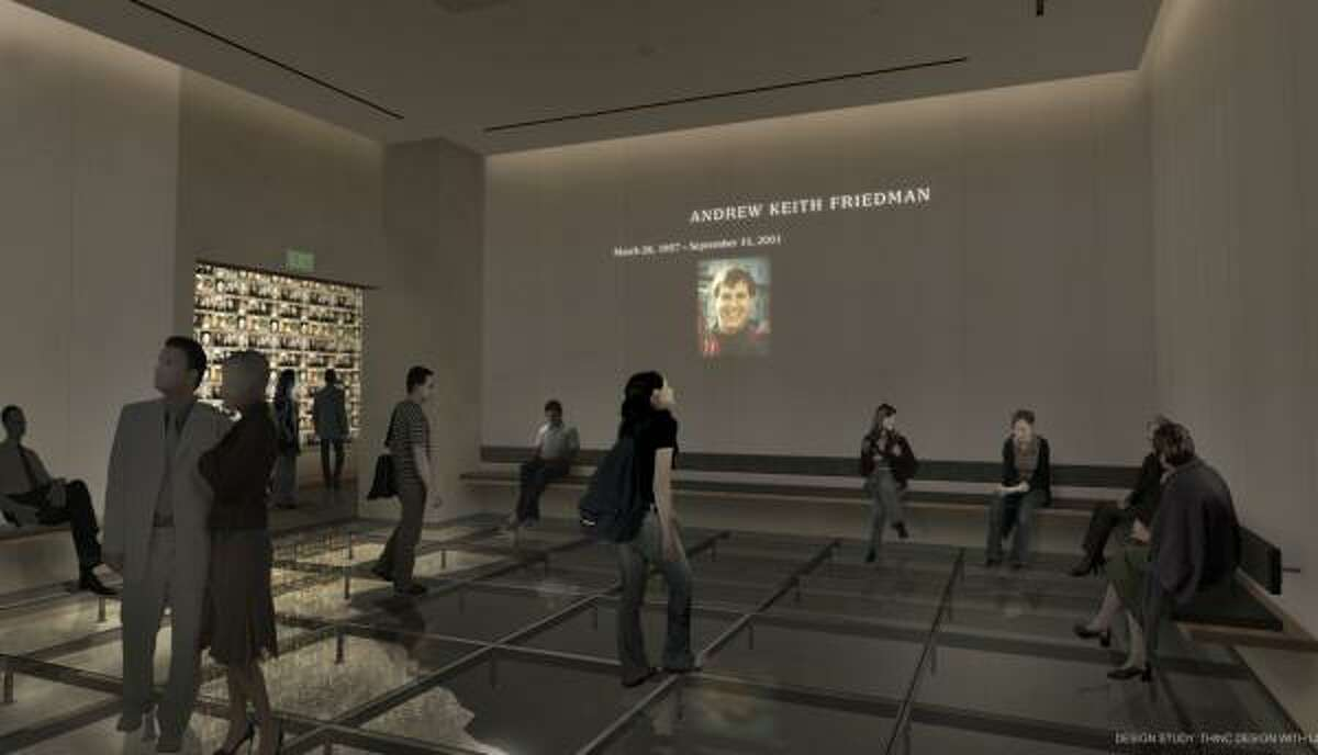 This undated artist's rendering provided by the National September 11 Memorial & Museum shows a planned exhibition gallery that will include a wall of photographs of every victim of the 2001 attack and 1993 World Trade Center bombing. The room features a glass floor set above the actual bedrock from the original trade center.