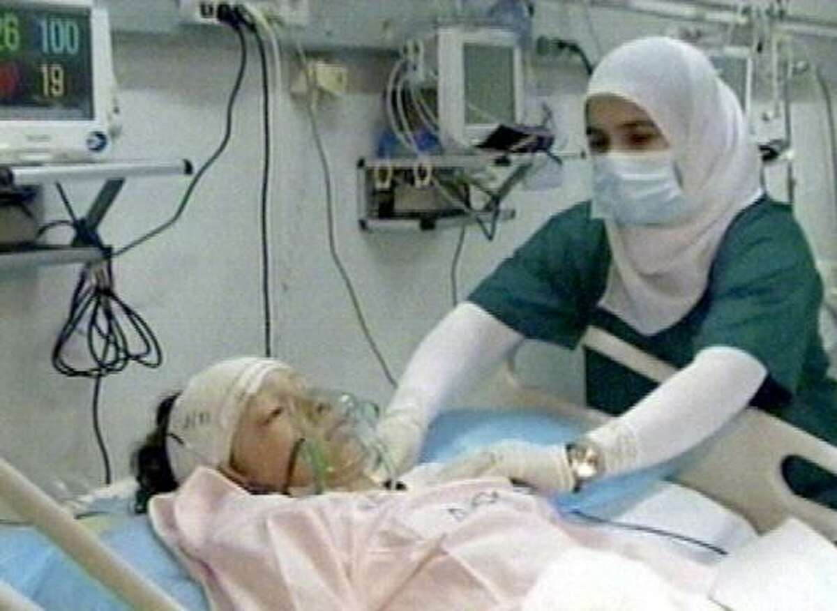 In this image made Wednesday, May 12, 2010, from Libya TV, a 10 year-old Dutch boy, the only known survivor of the crash of an Afriqiyah Airways plane crash in Tripoli, is treated in a hospital.