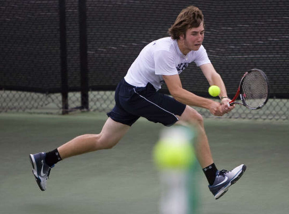 Conroe Woodlands College Park High School's Nick Naumann chases a ball for a return against Tyler Lee High School players during his 4a UIL State Championship doubles match with partner Nate Lammons.