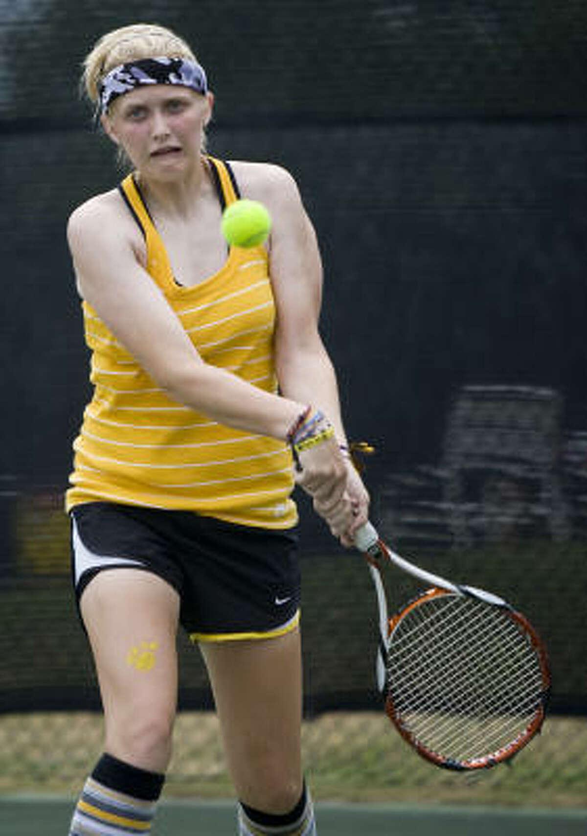Klein Oak High School's Melissa Burckhartt returns a ball from Klein High School players.