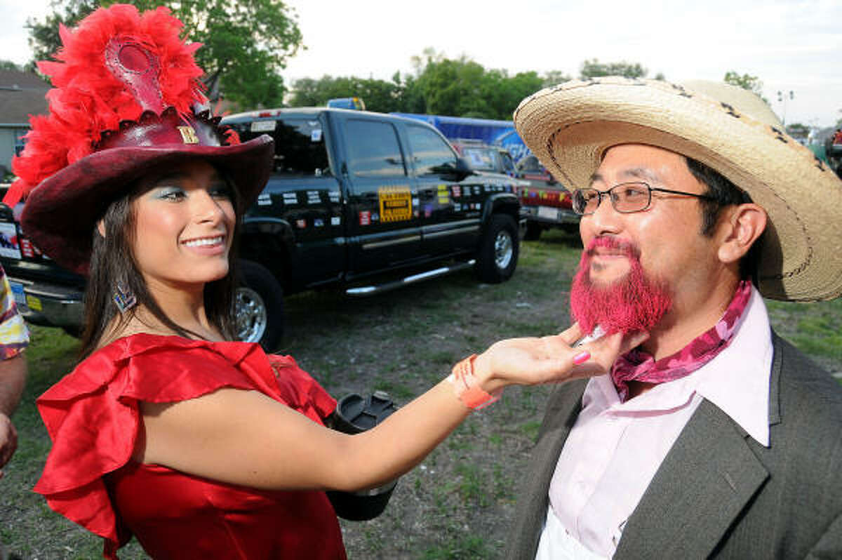 Bruna Dew checks out Fujio Watanabe's pink beard.