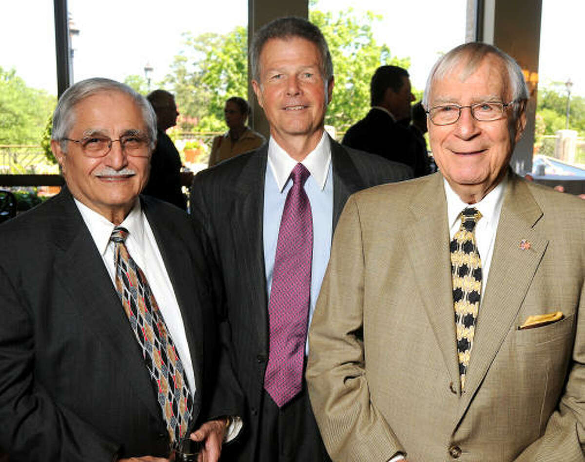 From left: Adan Trevino, Philip Bahr and Gerald Bush at the Men of Distinction Annual Awards Luncheon.