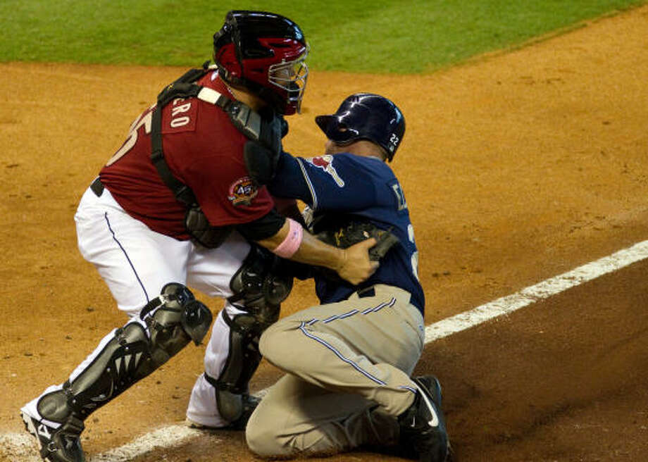 Astros catcher Humberto Quintero puts the tag on Padres David Eckstein trying to score from third during the ninth inning. Photo: Smiley N. Pool, Chronicle