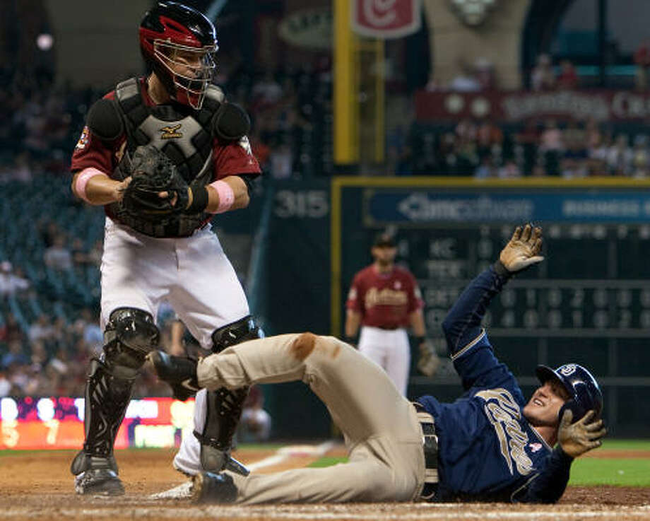 Humberto Quintero stands over San Diego Padres David Eckstein after tagging him out trying to score from third. Photo: Smiley N. Pool, Chronicle