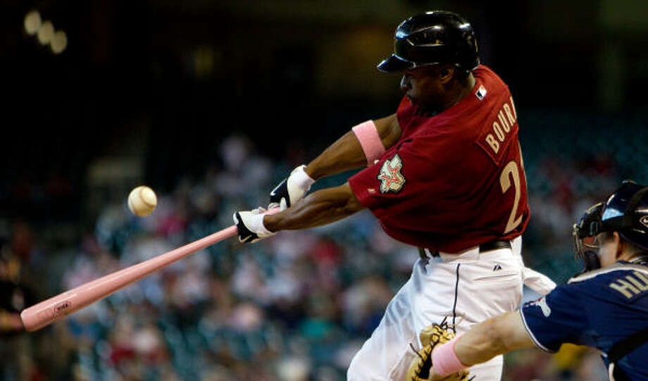 Using a pink bat in celebration of Mother's Day and the Going to Bat Against Breast Cancer Initiative, Astros center fielder Michael Bourn hits a leadoff single in the first inning. Photo: Smiley N. Pool, Chronicle