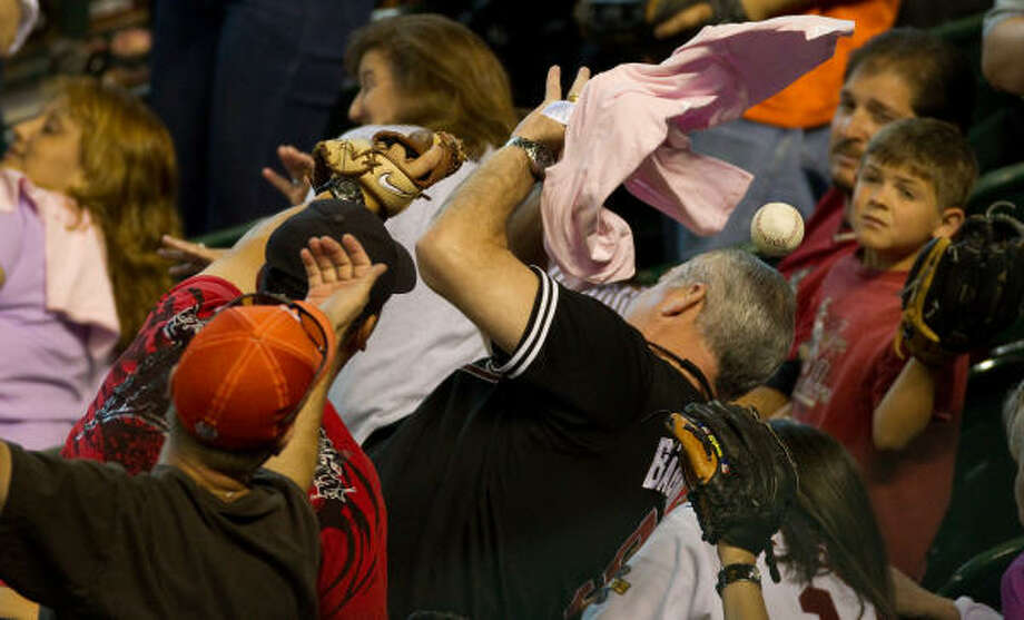 Fans scramble for a foul ball during the sixth inning. Photo: Smiley N. Pool, Chronicle