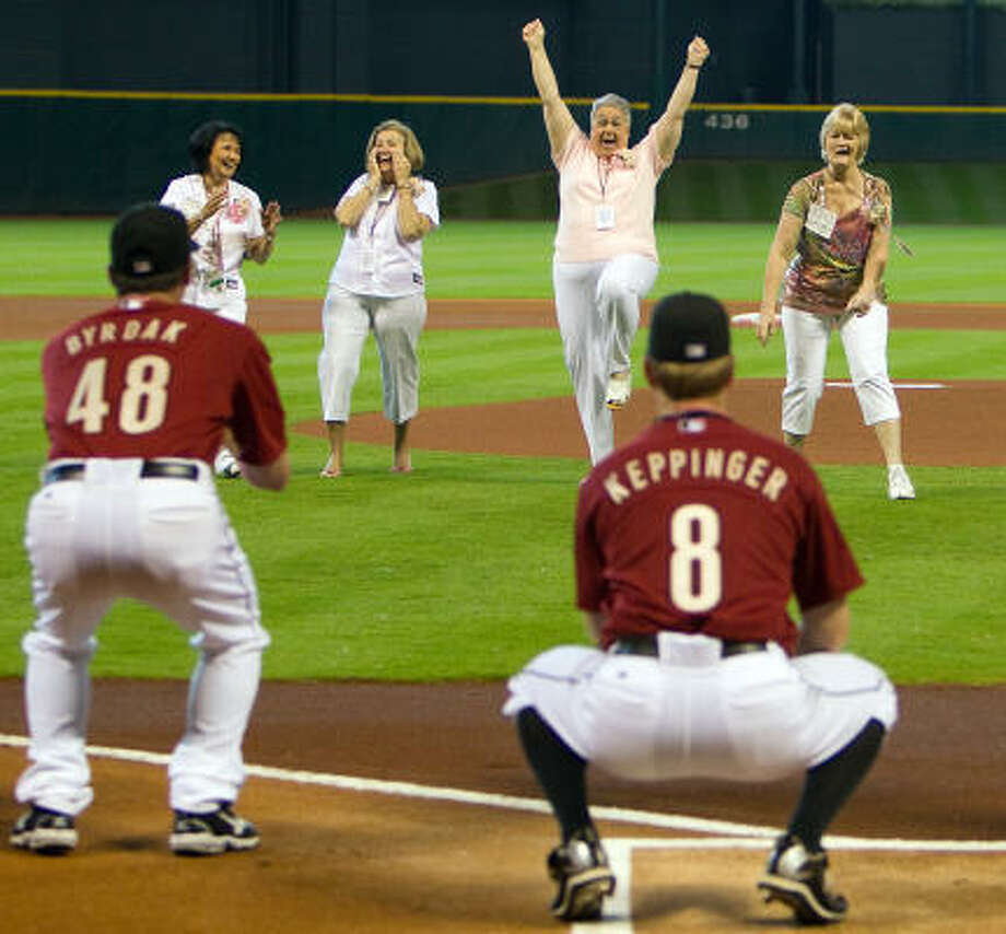From left, Astros relief pitcher Chris Sampson's mom Linda, starting pitcher Bud Norris's mom Suzi, relief pitcher Tim Byrdak's mom Sharon and second baseman Jeff Keppinger's mom Valerie celebrate after throwing out ceremonial first pitches. Photo: Smiley N. Pool, Chronicle
