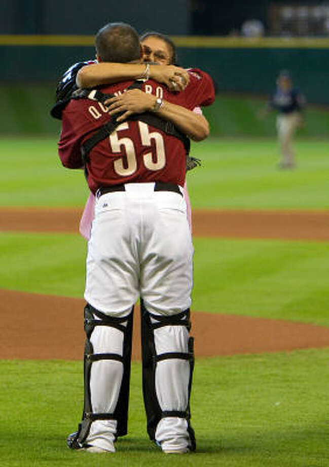 Astros catcher Humberto Quintero hugs his mom Nelly before the game. Photo: Smiley N. Pool, Chronicle