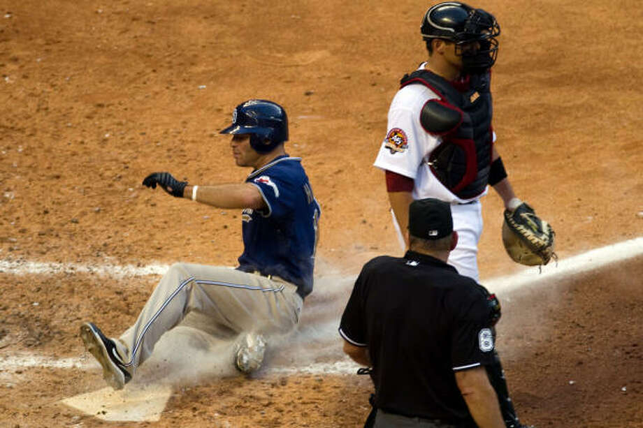 Padres center fielder Scott Hairston slides past Astros catcher Kevin Cash as scores without a play on a sacrifice fly by Chase Headley in the sixth inning. Photo: Smiley N. Pool, Chronicle