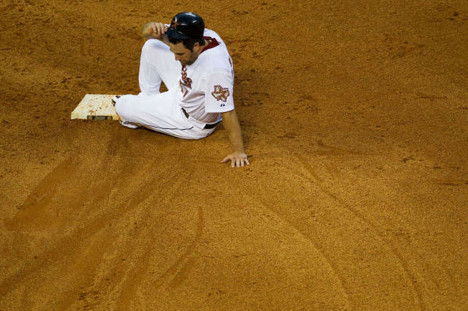 Astros first baseman Lance Berkman takes his time getting up after being erased on the front end of an inning-ending double play off a grounder by Carlos Lee in the seventh inning. Photo: Smiley N. Pool, Chronicle