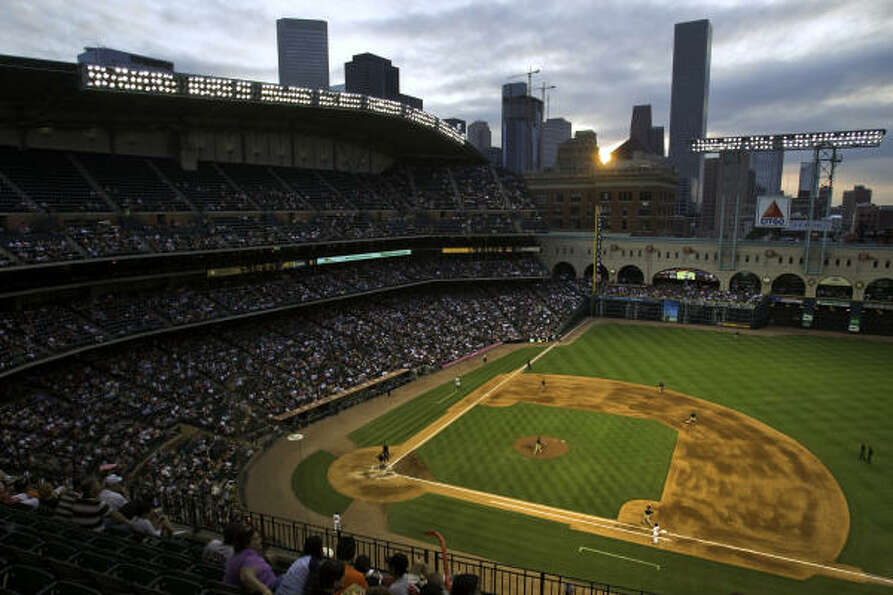 The sun sets over the downtown skyline as the Astros face the Padres on Saturday at Minute Maid Park