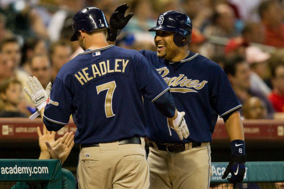 Padres third baseman Chase Headley (7) celebrates with teammate Yorvit Torrealba after hitting a home run off Astros starter Bud Norris during the third inning. Photo: Smiley N. Pool, Chronicle