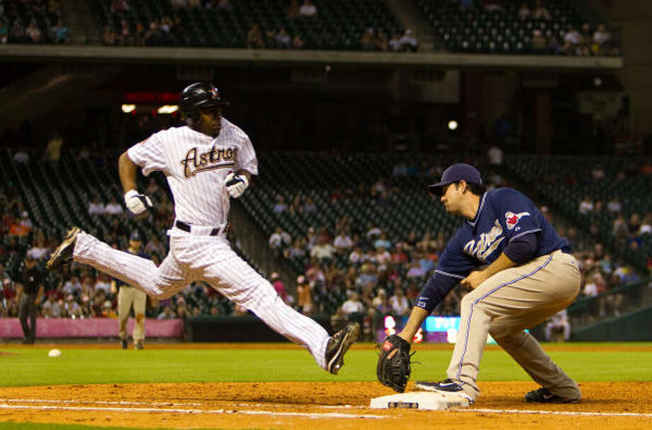 Houston's Michael Bourn can't beat a throw to first base as Padres first baseman Adrian Gonzalez records the out in the ninth inning. Photo: Smiley N. Pool, Chronicle