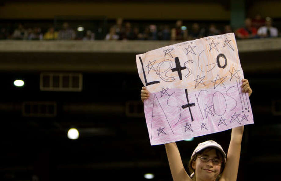 A young Astros fan sticks by her team during the eighth inning. Photo: Smiley N. Pool, Chronicle