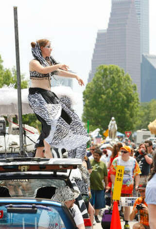 "Lindsey Jones, of Austin, dances on ""Zena"" before the parade. Photo: Nick De La Torre, Chronicle / HC"