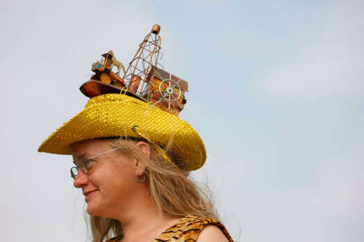 "Erika Nelson of Lucas, Kan., sports an oil rig hat with her art car entry, ""Scout."" Photo: Nick De La Torre, Chronicle"