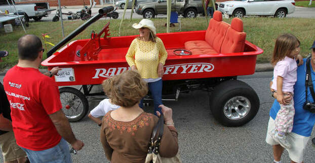 "Joy Davis from San Francisco shows off her friend's art car, ""Radio Flyer."" Photo: Nick De La Torre, Chronicle"