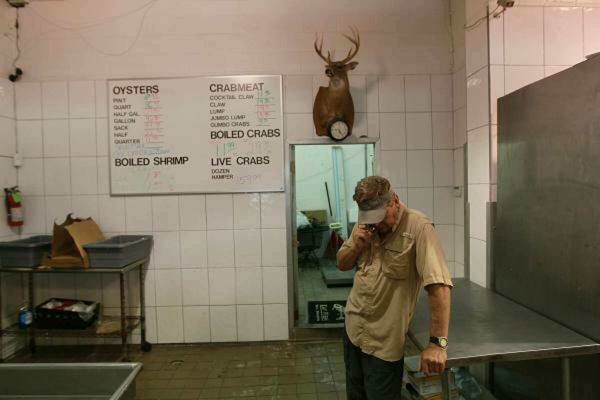 Captain Pappy Kenney talks on the phone at his seafood store in Slidell, La. Kenney said he anticipates the price of shrimp and other food caught in the Gulf rising due to the massive oil spill in the Gulf of Mexico.