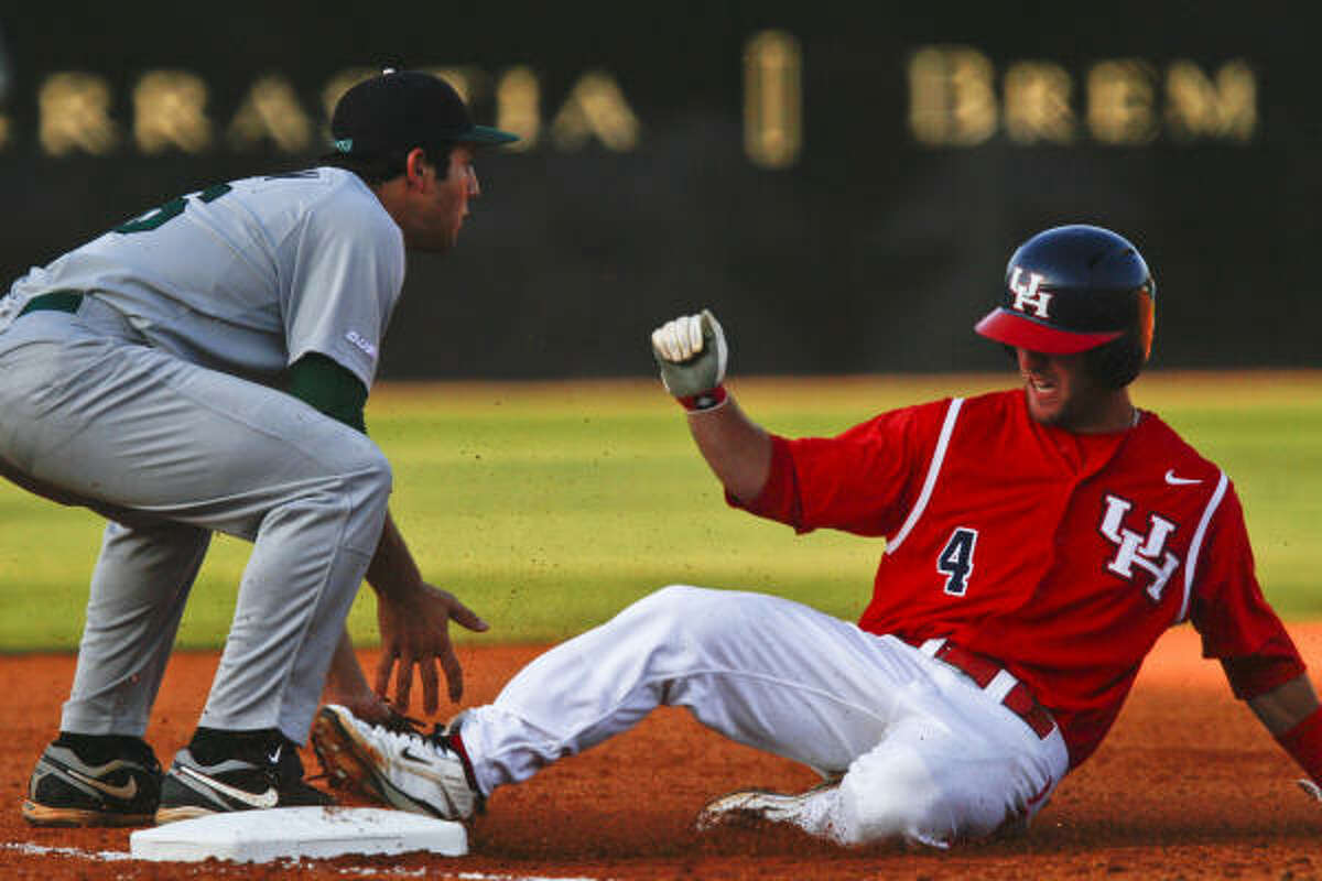 UH's Joel Ansley slides safely into third base as Tulane's Rob Segedin tries to make a play during Friday's game at Cougar Field. UH won 9-7.
