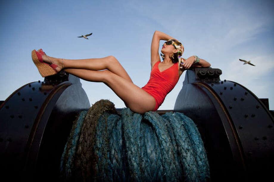 Karla Collette orange one-piece, $300, La Mode Swimwear. Photo: Smiley N. Pool, Chronicle