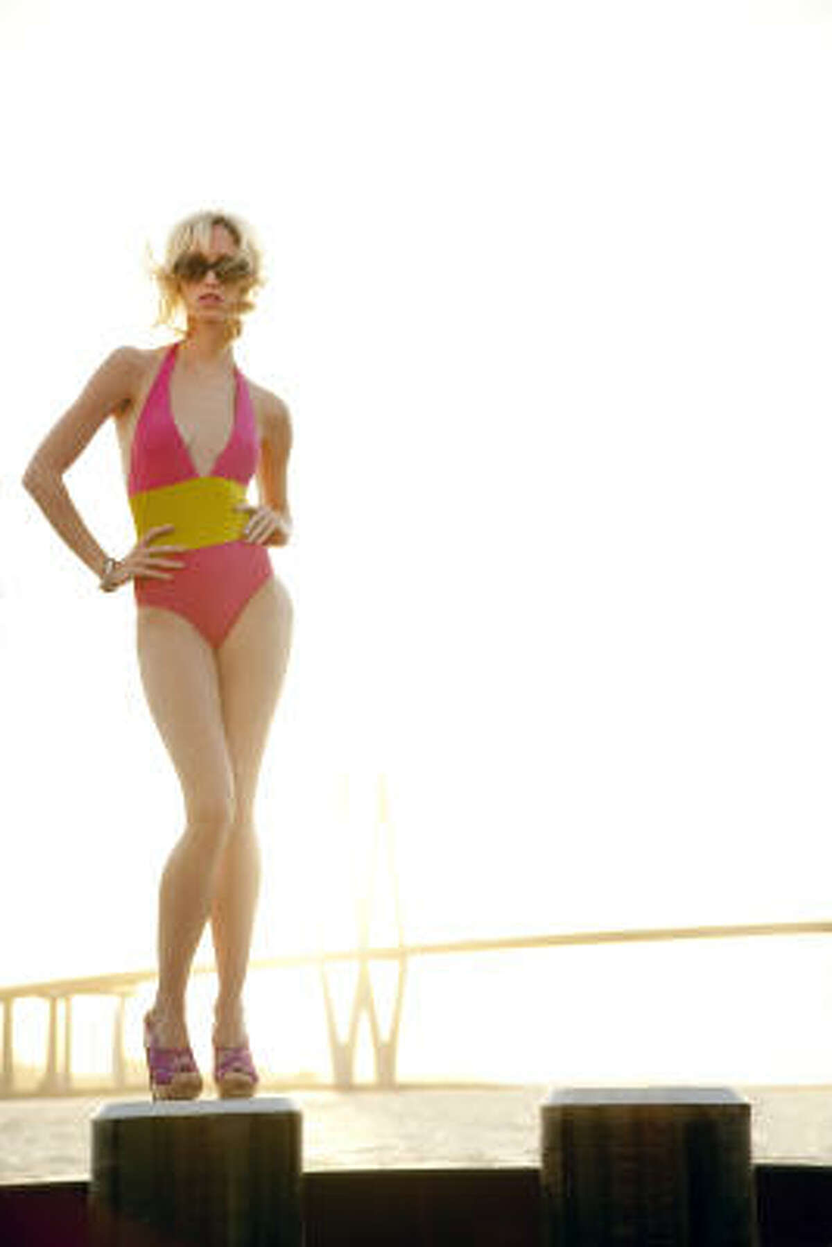 Leopoldine Golunski of the Neal Hamil Agency wears an Eres one-piece, $568, La Mode Swimwear. Lanvin floral platforms, $950, and Chanel sunglasses, $270, Neiman Marcus. Styling by Dawn Bell. Hair and makeup by Tree Vaello, Page Parkes Models.