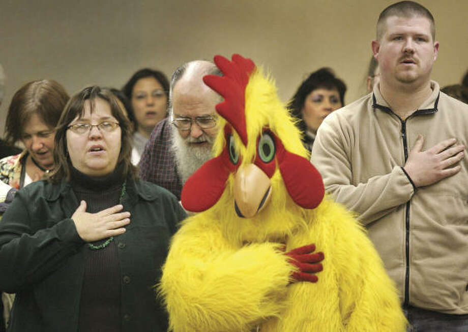 You have to appreciate someone who shows up wearing a chicken suit at a Janesville City Council meeting in February  in support of a proposed ordinance change that would allow residents to keep chickens in their back yards. The ordinance change was rejected by the Wisconsin council. Photo: Bill Olmsted, AP