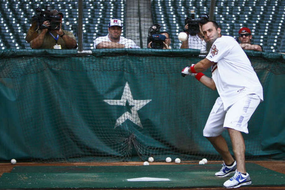 Texans quarterback Matt Schaub takes a turn at bat during the Texans' annual Reliant Energy Home Run Derby. Photo: Michael Paulsen, Chronicle