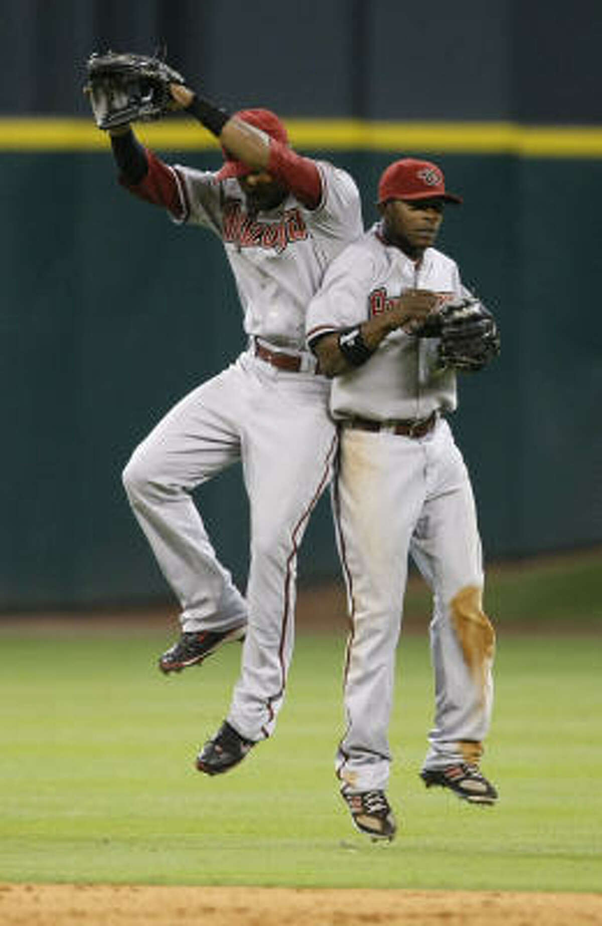Diamondbacks center fielder Chris Young, left, and right fielder Justin Upton celebrate as they beat the Astros 6-3.