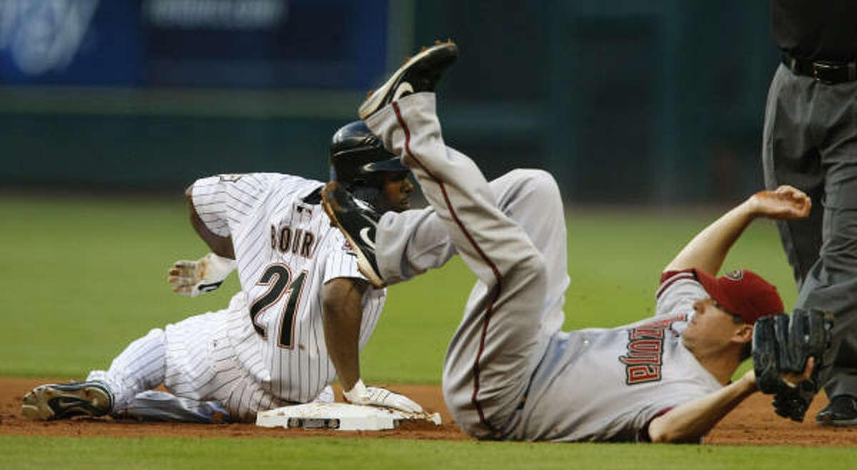 Astros center fielder Michael Bourn, left, slides safely into second base under the tag of Diamondbacks second baseman Kelly Johnson.