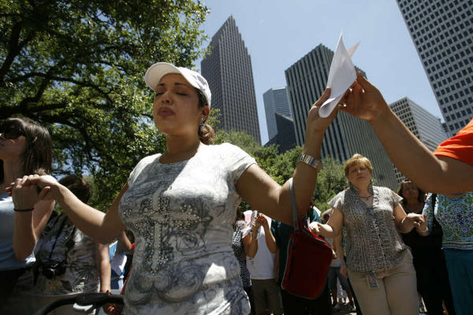 """It's the holy spirit in me"" says Cecilia Campos, 30, when asked why she was weeping during prayers at the ""For Such A Time As This"" National Day of Prayer event at the steps of Houston City Hall in Houston. Photo: Mayra Beltran, Chronicle"