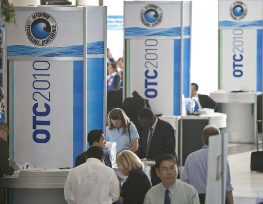 Offshore Technology Conference attendees fill out paperwork to gain admittance to visit with more than 2,000 companies Monday, May 3, 2010, at Reliant Center in Houston. OTC includes attendees from around the globe, with more than 100 countries represented. Photo: Nick De La Torre, Chronicle