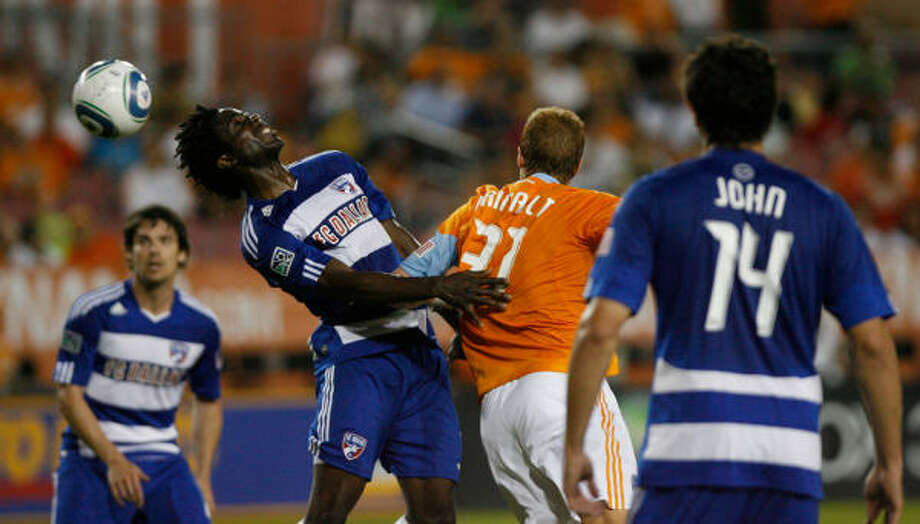 FC Dallas defender Ugo Ihemelu, left, deflects a throw-in late in the first half. Photo: Julio Cortez, Chronicle