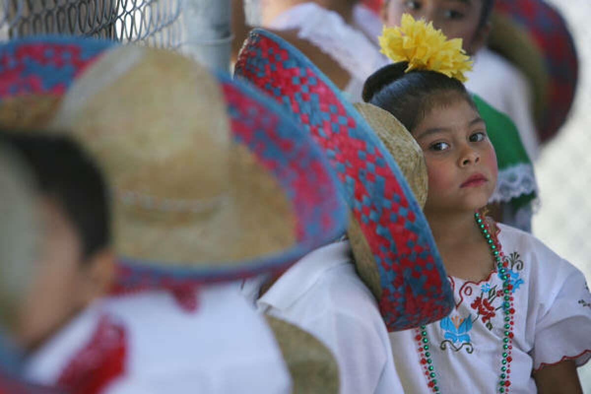 Victoria Terrazas, 6, patiently waits her turn to perform during the Cinco de Mayo celebrations at the Varnett Public School in Houston.